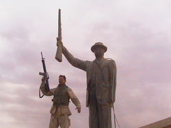 At the Al Quds power plant, North Baghdad, in front of an untoppled statue of Saddam Hussein. April 15, 2003