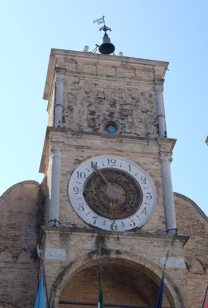 A close-up of the clock tower on Pordenone's Communal Palace.